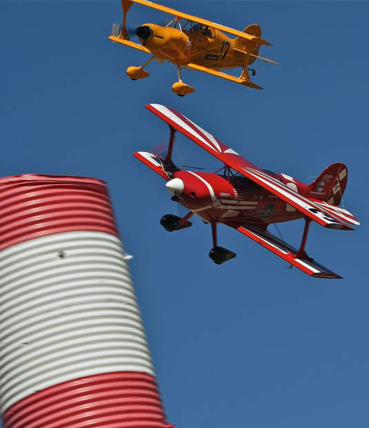 Biplane Class racers in competition during a six lap race on a 3.2 mile course.