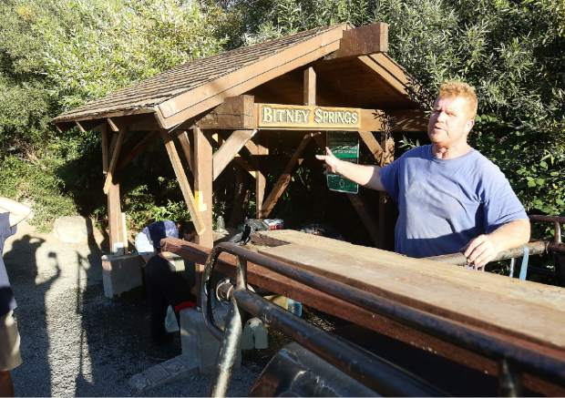 Bitney Springs user and community helper Brad Miller, stands on the tailgate of his pickup that he used as an anchor to help straighten out the springs' structure which was damaged earlier this week by a vehicle that got too close. Miller, along with other helpers, plans to be back at work on the structure over the weekend.