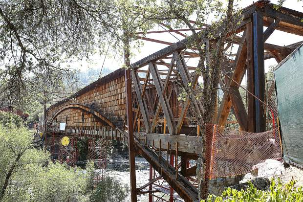 The roof and many wooden shingles have been removed from the Bridgeport Covered Bridge to make way for the restoration efforts.