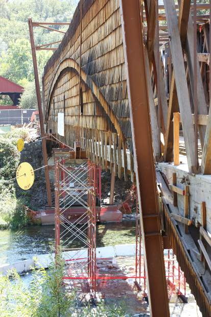 Metal support structures are in place on the 1862 Bridgeport Covered Bridge as restoration work continues. Officials have said the bridge could reopen by year's end.