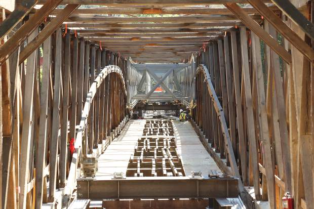 The inner framework of the 1860s historic Bridgeport Covered Bridge is exposed as workers from Spectra Contractors of Pomona work to install metal supports that will allow the bridge to be safely raised to the height desired for the restoration. Officials have said the bridge could reopen by year's end.