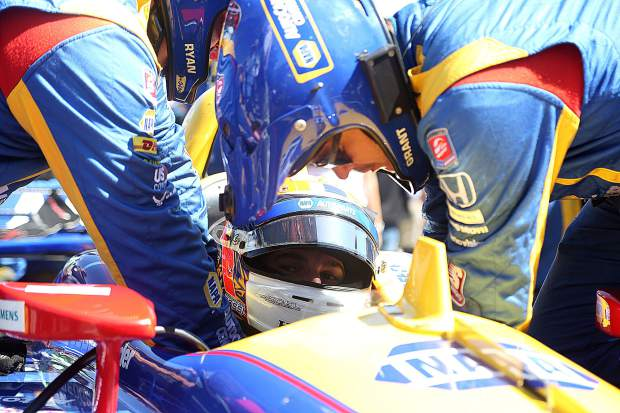 Nevada City native Alexander Rossi gets strapped in to his #27 Napa Auto Parts IndyCar prior to the race Sept. 22 at Laguna Seca.