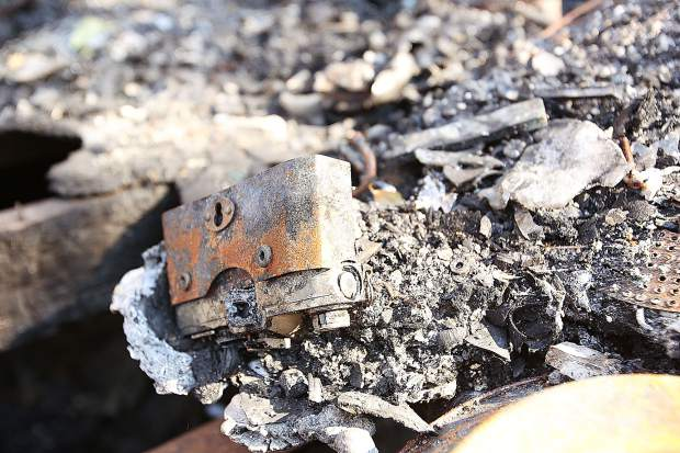 A vintage film SLR camera is fused into the floor, along with other bits of melted metal, following a structure fire that destroyed Rick Toles' Rough and Ready home. The remnants have been hauled away now as Toles begins the rebuilding process.