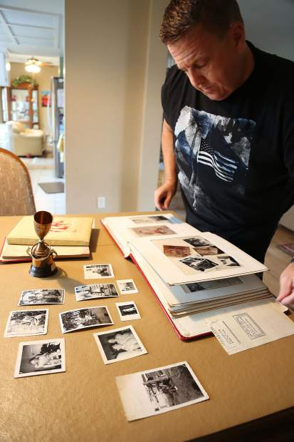 Philip Desmit displays some of the personal items that he has from his mother Joanne Dolly Burmer, given to him after she disappeared including her school yearbooks, a billiards trophy, and photos.