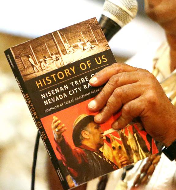 Nisenan Tribal Chairperson Richard Johnson holds a copy of the book he wrote which compiles a history of the Nisenan tribe in Nevada County.
