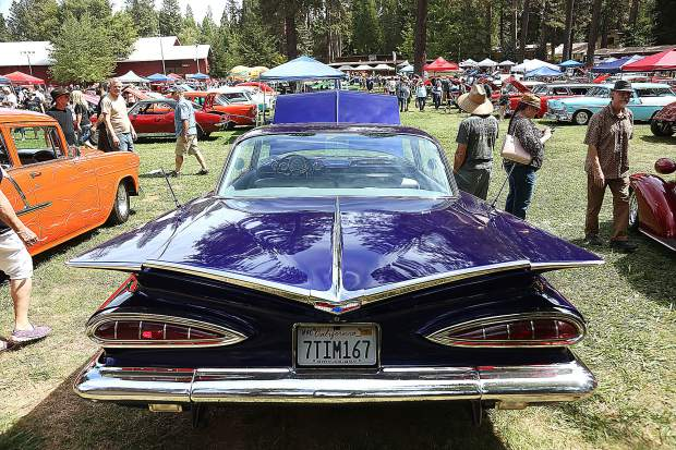 The wings of this purple 1959 Chevy Impala caught the attention of many car show goers.