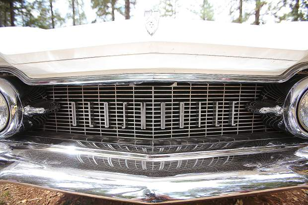 The grill of an old Oldsmobile sits among the pines during the Roamin Angels Cruisin the Pines Car Show.