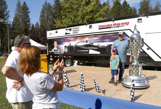 People pose with Alexander Rossi's Borg-Warner Trophy during the Roaming Angels Car Show at the Nevada County Fairgrounds Sunday morning.