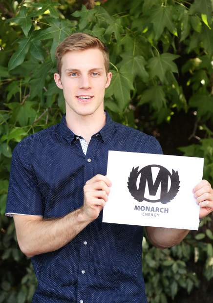 Energy supplement start up entrepreneur Mason McGuire holds the logo to his company Monarch Energy. Monster Energy has filed a notice of opposition against McGuire with the argument that his company logo infringes on its copyright due to similarities.