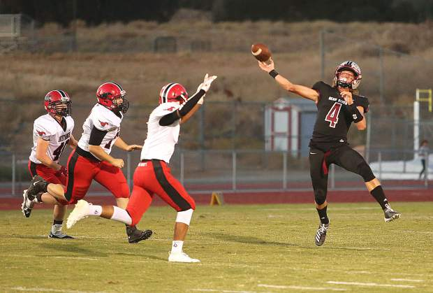 Bear River Bruins' varsity quarterback Tre Maronic fires a deep touchdown pass against the Pershing County Mustangs during Friday's blowout win.