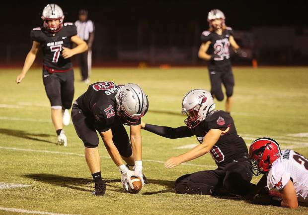 Bear River's Jaime Vargas helps to pick up a fumble for the Bruins during Friday's win.