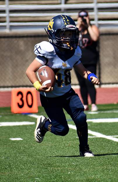 Nevada Union 8U Jr. Miners running back Urijah Painter carries the ball during his team's 40-0 victory over Bella Vista Saturday.