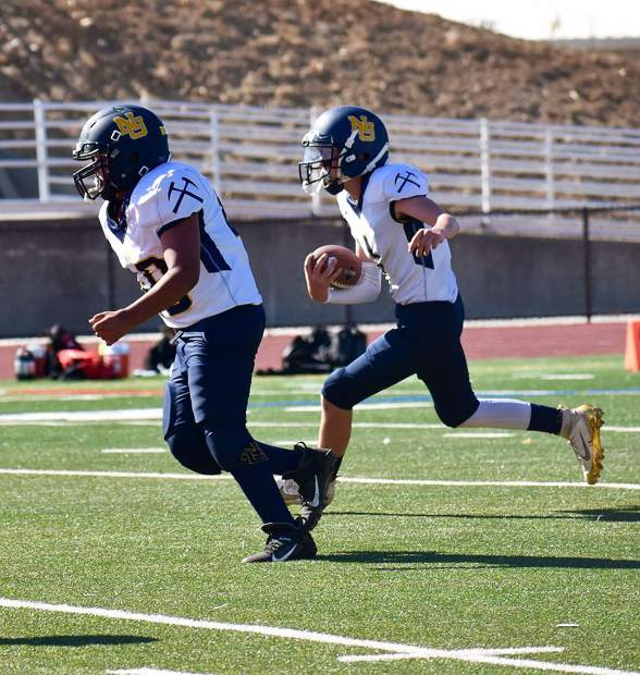 Nevada Union 14U Jr. Miners quarterback Nolan Chappell carries the ball during his team's 13-12 victory over Bella Vista Saturday.