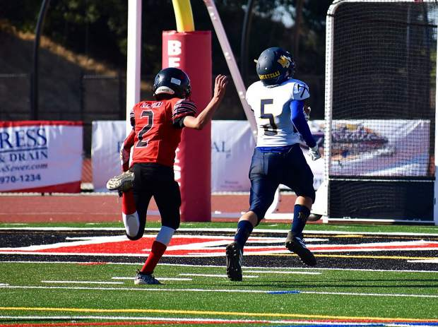 Nevada Union 14U Jr. Miners receiver Ben Locatelli carries scored a touchdown during his team's 13-12 victory over Bella Vista Saturday.