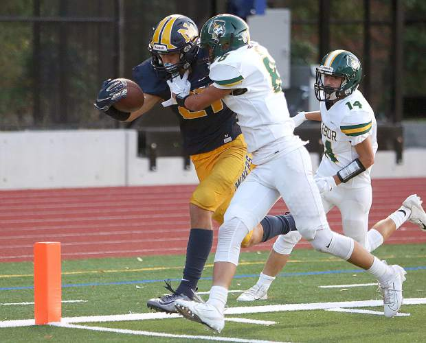 Jaxon Horne reaches over the end zone for a touchdown against the Harbor Pirates Saturday in Santa Cruz.