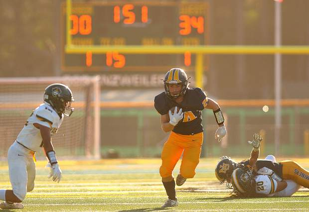 Jaycee Youngman (24) runs the ball for the Miners.