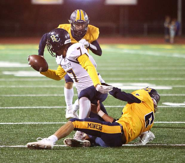 Nevada Union varsity defenders Zach Erhlich (6) and A.J. Meyer (4) take down a River City ball carrier during Friday's home win for the Miners over the Raiders last week.