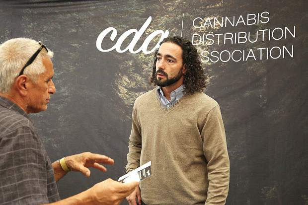 Demetrius Daniels of the Cannabis Distribution Association, answers questions from attendees of Thursday's Cannabis Alliance Farm to Market showcase.