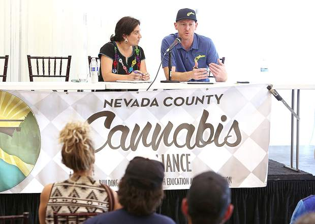 Nevada County cannabis compliance officer Thomas Maioli talks about how to get grows into legal compliance with the county while seated with the  Cannabis Alliance's Diana Gamzon.