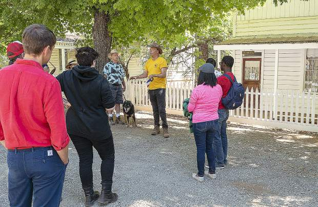 Chris Ward, a volunteer at Malakoff Diggins State Park, leads a tour of the town where French people lived.