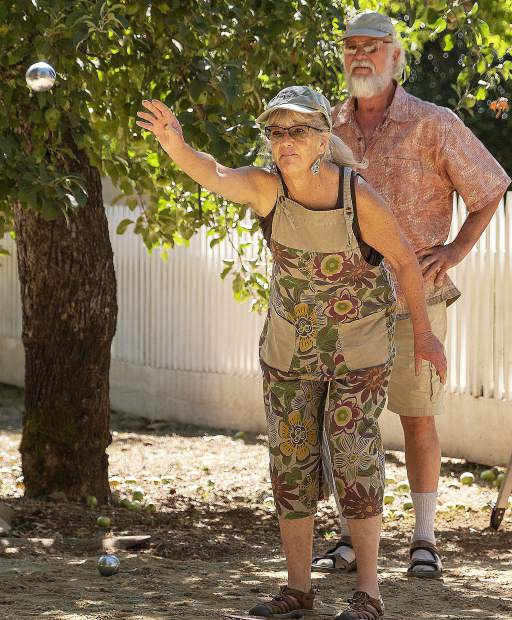 Residents of the North San Juan Ridge area play the French game Pétauque in their back yard. A Pétauque court was built at Malakoff State Park for the celebration. Patti Carballar tossed the boules (ball) to a orange ball, and whoever gets their boules closest orange ball gets one point.