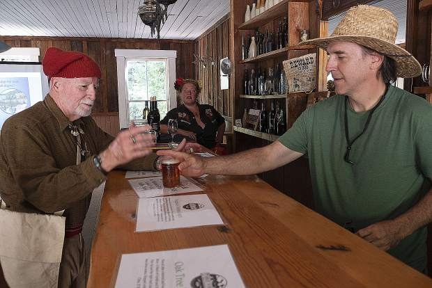Luke Rtten a volunteer at the festival served Three Forks Beer of Nevada City to Mike Vasser in the town saloon.
