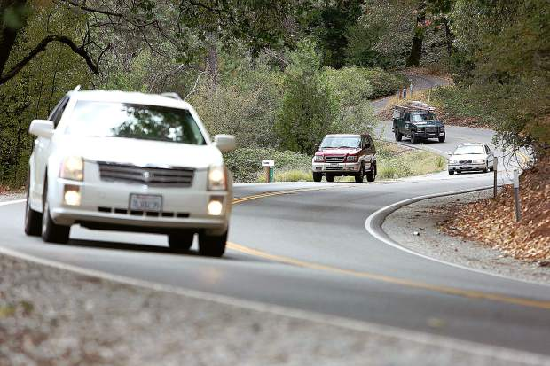 Vehicles navigate the turns of Highway 174 between You Bet Road and Maple Way in rural Nevada County, where Caltrans is planning to make the roadway safer.