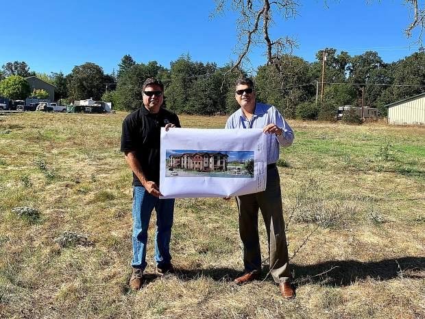 From left, Nevada County Planning Director Brian Foss and Gustavo Becerra, executive director of the Regional Housing Authority. Nevada County has received over $7 million in federal low-income housing tax credits for the Lone Oak Senior Apartments in Penn Valley.