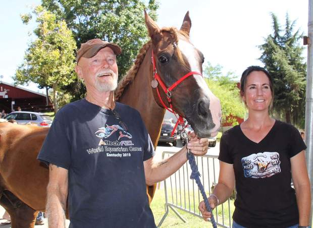 Owner Chris Martin of Penn Valley, endurance equine star Monk, and rider Lindsay Fisher, DVM, of Napa.