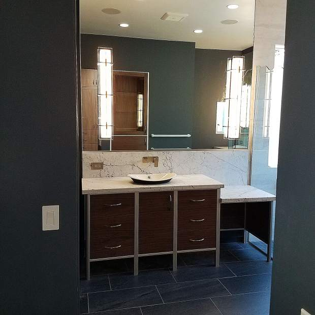Muted colors transform a modern bathroom in the house of Sundance Colors clients.