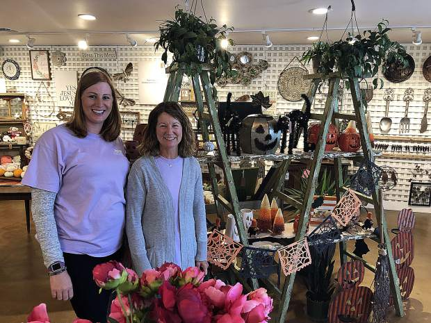 From left, manager Feona Nowak and employee Stacy Hereford show off some of the new Halloween goodies at Wildflower Nursery Garden and Gift Shoppe.