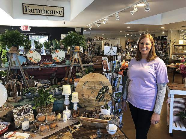 Manager Feona Nowak stands next to some of the new autumn inventory at Wildflower Nursery Garden and Gift Shoppe.