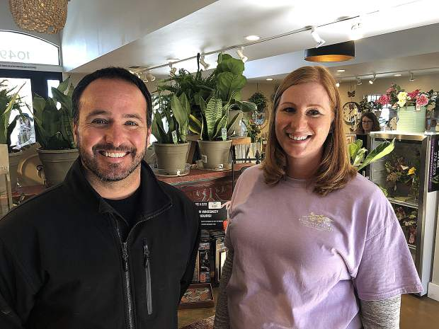 From left, Scott Gutierrez (who owns Wildflower Nursery with his wife Rory) and manager Feona Nowak pose inside the gift shop at Wildflower Nursery Garden and Gift Shoppe in Penn Valley.
