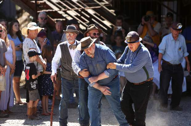 Empire Mine docents re-enact a a mine accident and rescue during the Miners Picnic.