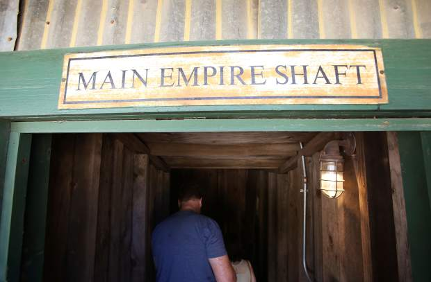 Folks begin their tour of the Main Empire Mine Shaft during the 124th Miners Picnic at Empire Mine State Park.