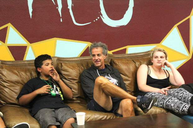 NEO board member Marty Lombardi interacts with the kids of the youth drop in center during Wednesday's 11-year anniversary.