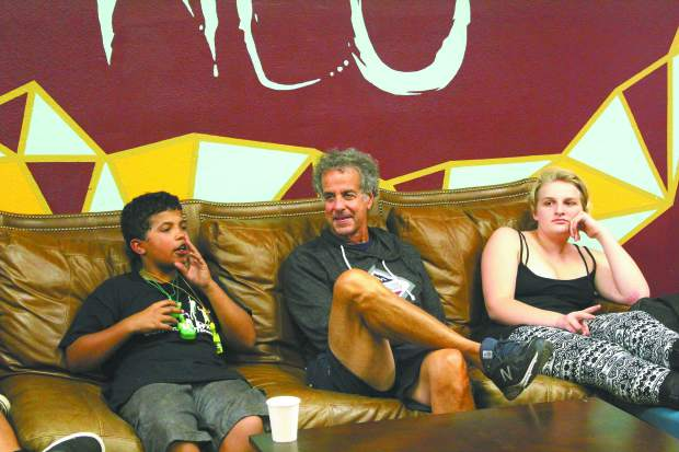 NEO board member Marty Lombardi interacts with the kids of the youth drop in center during Wednesday's 11 year anniversary.