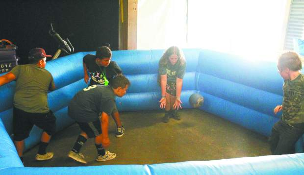 NEO youth play a game of Gaga Ball in the warehouse during Wednesdays' events.
