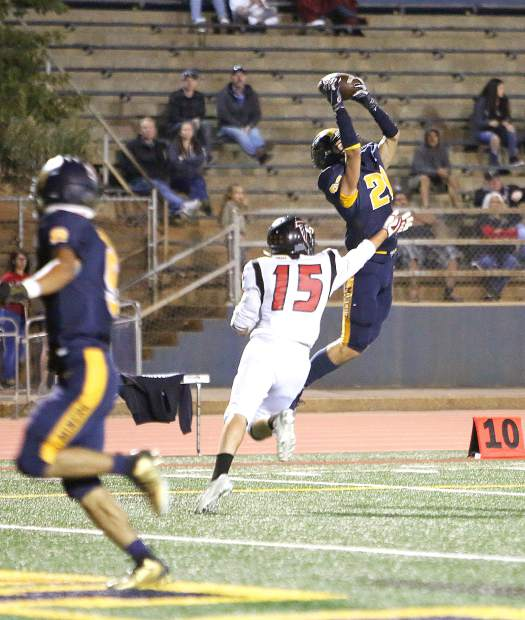 Nevada Union wide receiver Jaxon Horne (21) catches a pass from quarterback JT Conway before scoring during Friday's homecoming win over the Fairfield Falcons.