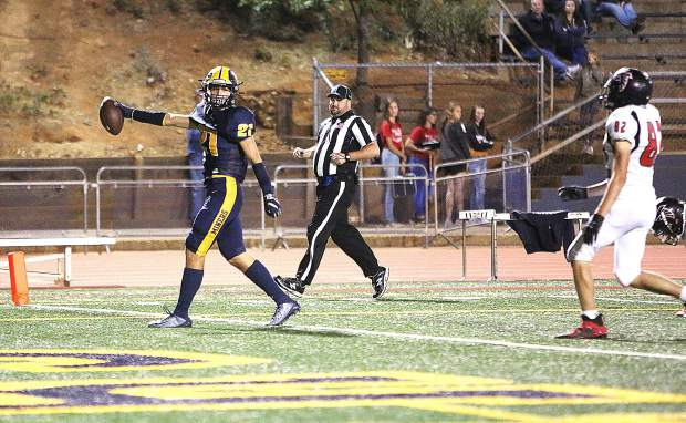 Nevada Union wide receiver Jaxon Horne (21) walks across the end zone after catching a pass from quarterback JT Conway during Friday's homecoming win over the Fairfield Falcons.