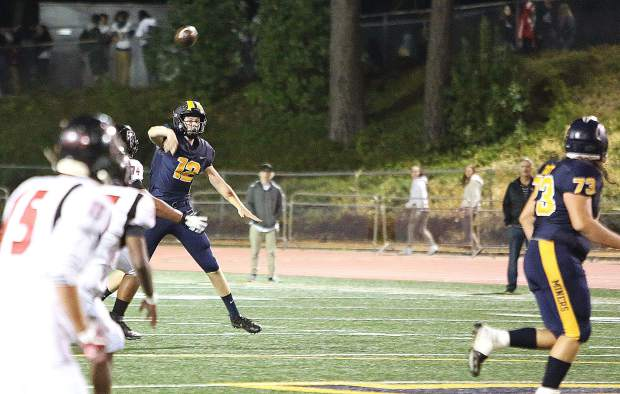 Nevada Union quarterback J.T. Conway (12) fires a pass during Friday's home win over the Fairfield Falcons.