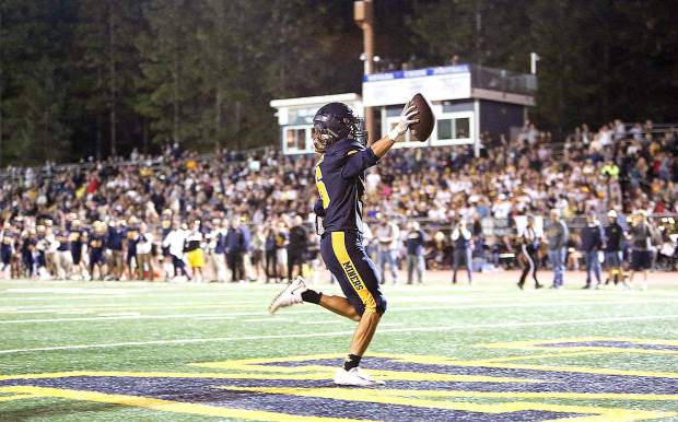 Nevada Union senior Zach Ehrlich (6) celebrates scoring a touchdown in front of a standing room only home crowd at Hooper Stadium during Friday night's 64-0 homecoming win over the Fairfield Falcons.