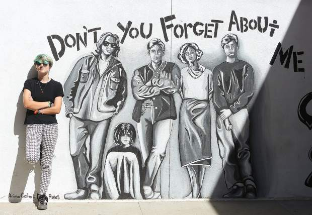 High schooler Ori Rutledge, an intern with The Union, leans against a wall at Nevada Union High School, to show the scale murals students created to help liven up the hallways. The Nevada County Arts Council is celebrating this week, promoting arts programming in schools, as well as arts projects going on in Nevada County more broadly.