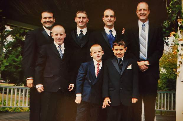 The Peterson family. Daniel is back row, second from left. His father Dan far right. The family has organized a GoFundMe campaign to support Daniel's unborn child and long-time partner.