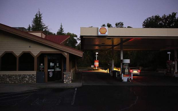 The Taco Shell gas station in Penn Valley sits dark Wednesday morning as motorists check to see if the pumps were working during Wednesday morning's public safety power shutdown in the Sierra foothills.