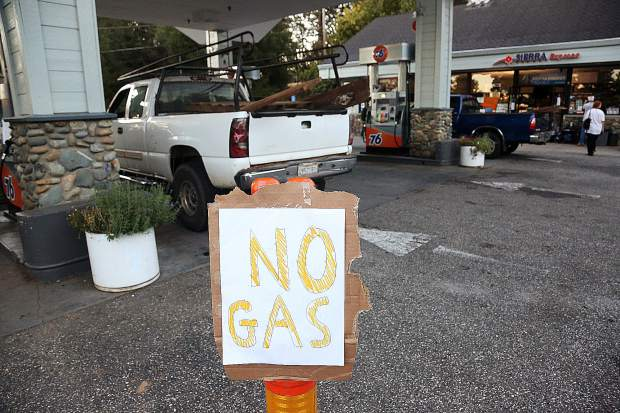 A Sierra Express 76 gas station places a sign stating that its pumps are down due to the PG&E power shut down in Penn Valley Wednesday morning. Generators helped to keep the convenience store open, though credit cards were not being accepted.