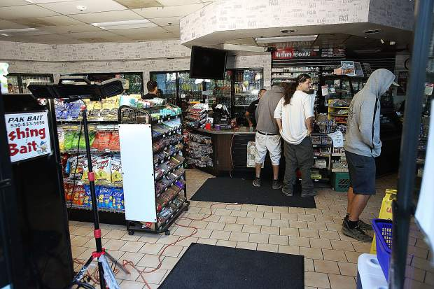 Customers shop at this Sierra Express in Penn Valley with the help of generators and light stands.