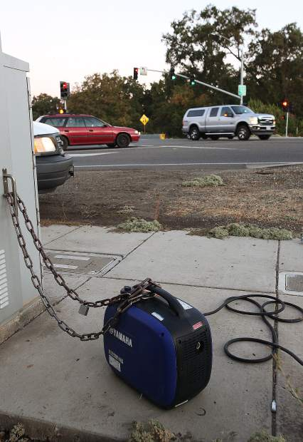 A small generator is used to keep the light signals working at the intersections of Highway 20 through Penn Valley Wednesday morning.