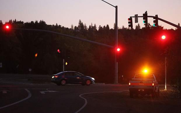 Caltrans workers helped to keep the stop lights working along the Highway 20 corridor with generators due to the PG&E public safety power shutdown in Penn Valley.
