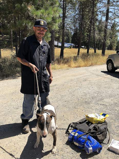 A homeless individual holds onto his dog with a leash. Hospitality House hopes to provide shelter for people like him before winter hits Nevada County.